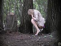 Cute bridesmaid pees in the woods