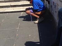 Black African tourist pees in daylight